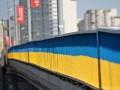 В Киеве желто-голубые заборы перекрашивают в серый цвет