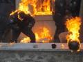 День в фото: горящие милиционеры и марш «титушек»
