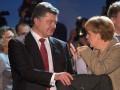 Порошенко обсудил с Меркель помощь МВФ