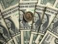 Курс доллара немного вырос к закрытию межбанка