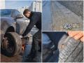 В Киеве из-за ям водители массово пробивают колеса