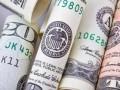 Финансисты прогнозируют падение гривны до 26,2 за доллар