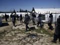 В Греции силовики начали снос крупного стихийного лагеря беженцев