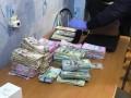 На Харьковщине у поселкового головы при обыске нашли $200 тысяч