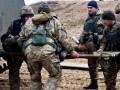 На Донбассе при тушении горящей травы от взрыва пострадал солдат