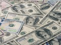 К закрытию межбанка доллар набрал 6 копеек