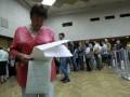 Ажиотаж на участках в Киеве: избиратели томятся в очередях (фото)