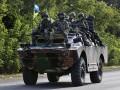 День в фото: солдаты возле Саханки и обстрел Новоазовска