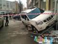 В Киеве со стрельбой напали на внедорожник и похитили сумку с деньгами