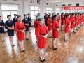 Сжатые колени, приветствие и улыбка: как в Китае учат быть стюардессами