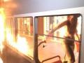В Виннице Femen подожгла трамвай возле магазина Roshen