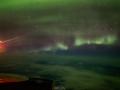 Фотограф снял северное сияние из окна самолета