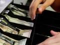 В США грабитель не справился с тяжестью украденного кассового аппарата