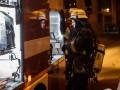 В горящей квартире в Киеве спасатели обнаружили тело с ножевыми ранениями