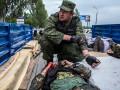 «Восток» против «Донбасса»: как террористы увозили убитых (фото)