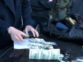 В Киеве судья попался на крупной долларовой взятке