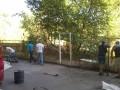 Жители Троещины снесли забор под Московским мостом