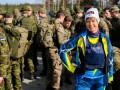 Президент Эстонии пробежала марш-бросок с военными