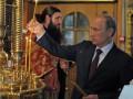 Владимир Путин поставил свечки за «защитников Новороссии» (видео)