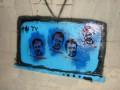 В центре Киева задержаны активисты, которые рисовали на портрете Януковича красную точку на лбу