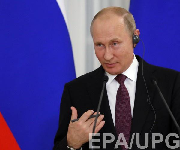Путин говорит, что еще не читал доклад следователей по MH17