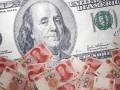 Юань обновил шестилетний минимум к доллару
