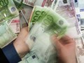 Комментарий: Еврозона продолжает тушить долговой пожар деньгами