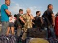 Правозащитники назвали реакцию Порошенко на закон о переселенцах фарсом