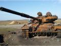 Места боев на Донбассе: останки солдат под открытым небом и сгоревшие танки (фото)