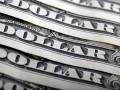 Курс доллара на первых торгах в Венесуэле превысил официальный в 8 раз