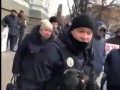 Кулаком в лицо: полицейский ударил участника акции под зданием НБУ
