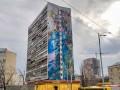 На доме в Киеве уничтожили масштабный мурал американского художника