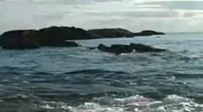 Ocean Waves Crashing over a rock
