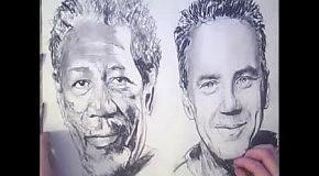 Художник одновременно рисует два портреты обеими руками