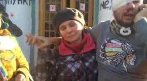 Раненый активист после боя на улице Институтской