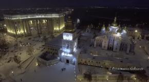 Заснеженный вечерний Киев с высоты птичьего полета